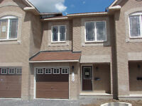 BEAUTIFUL TOWNHOME IN BARRHAVEN BACKING ONTO FOREST