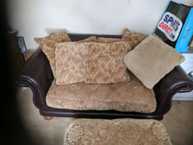2 Seater Sofa with Footstall and loads of cushions