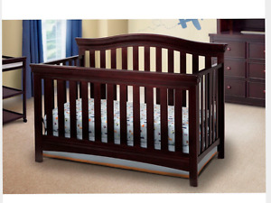 Brown convertible crib