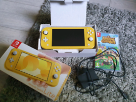 Nintendo switch lite with game ( Animal Crossing 2020)
