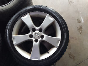 205 50 17 winter tire with mags for mazda