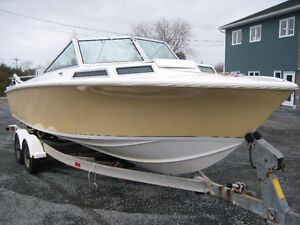 Fiberglass, Deep Hull Boat with Cuddy Cabin - 23.5 feet long