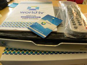 Décodeur WORLD TV non utilisé, tout neuf (voir plusieurs photos)