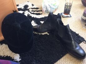 Horse riding black boots and riding hat