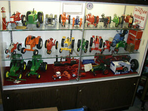 Collectible Toy Tractors,cars,bikes etc.with display cases
