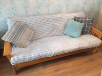 Very solid pine futon sofa bed. Very strong and heavy.