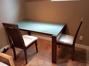 Glass top dining table set with six chairs
