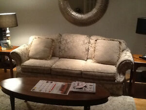 Beige sofa and chair