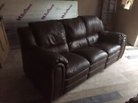 Dark brown leather sofa with two recliners