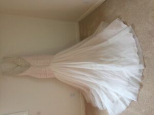 Stunning open back fit and flare gown, never worn!