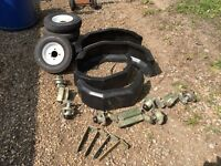 Trailer suspension wheels and mudguards