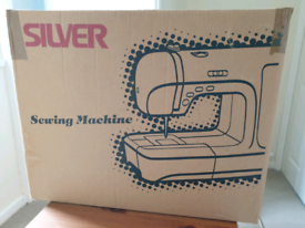 Silver 1045 Sewing Machine with Dressmaking Books