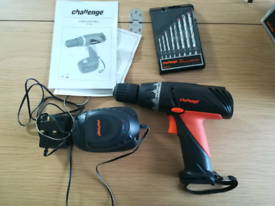 Challenge 9.6V cordless drill with battery pack and drill bits