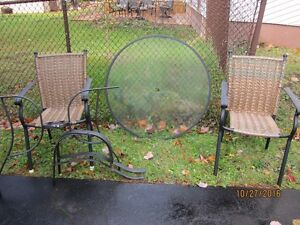 2 patio chairs and matching glass table