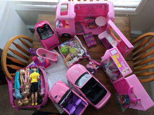 Lots of Barbie Dolls and accessories