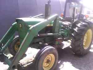 John Deere Tractor Model 1120 and Hardy backhoe model 8st