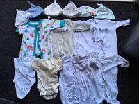 Bundle of newborn baby boys clothes