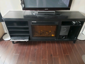 Entertainment unit with electric fireplace and heater