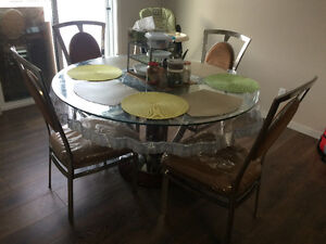 Brand new 4 PC glass dining table