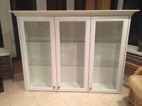 White glass display cabinet with interior lights