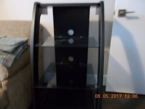 Beautiful entertainment unit with 2 glass shelves for sale