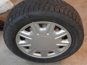 4 Winter Tires on Rims with Hubcaps