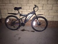 Brand new Boss Stealth mountain bike with dual disc brakes and suspension