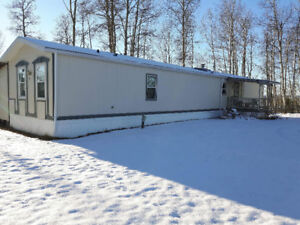 Mobile Home west of Rocky for rent.