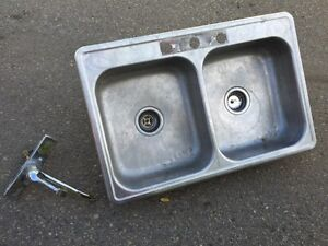 Double sink with faucet/tap. Stainless steel