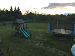 Swing set and trampoline
