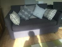 Lovely two seater sofa bed