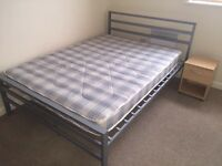 Standard double bed with mattress for £80. Free bedside table !