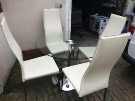Circular Glass Dining table x 4 Leather chair + local delivery