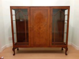 Antique walnut display cabinet.