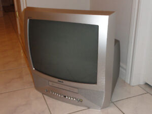 "RCA 19"" TUBE TV WITH BUILT-IN VCR ,    MOVIES AND  STORAGE RACKS"