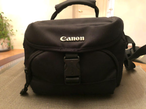 Canon EOS Rebel T2i camera with 2 lenses, flash and bag