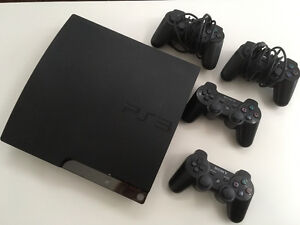 Playstation 3 (500GB) + 4 controllers + 14 games