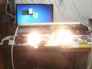 small tract light with 2 fixtures, silver and white.