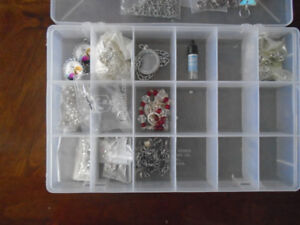 A large assortment of jewelry making supplies. Pendants, crimps,