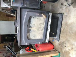 Wood stove and Chimney for sale only used 1 burning season