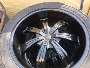 "22"" aluminum rims with tires."