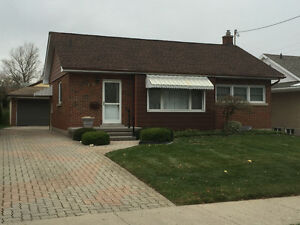 Solid Brick Bungalow on large lot c/w 2 Car detached garage