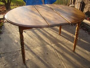 re-furbished solid wood dining table with leaf (no chairs)