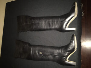 Pair of black over-the-knee calf leather Chanel heeled boots