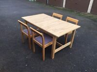 Ikea Solid light oak table with 4 chairs. Can deliver