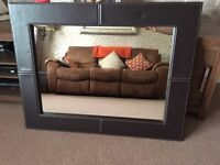 Large brown leather mirror.