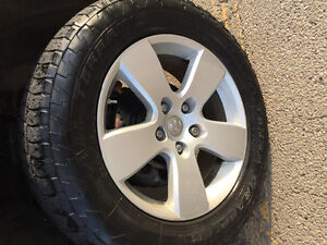 """20"""" Ram 1500 rims and tires."""