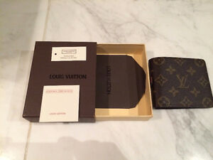 Men's LV Wallet. New. Comes with Original Case. Price is Firm.
