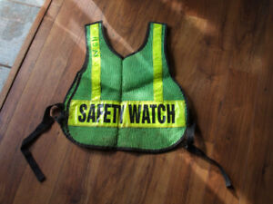 Lightly used florescent  safety vests
