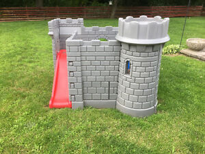 Castle play structure with slide
